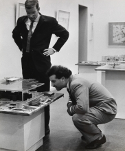 Constant Nieuwenhuys-Schulze Fielitz, German architect, and Swiss painter André Thomkins in front of model Red Sector, 1961