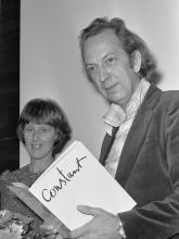 Constant with the catalogue of the exhibition Constant, een illustratie van vrijheid, 1974