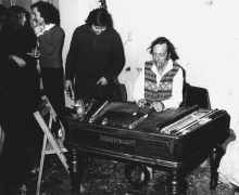 Constant Nieuwenhuys playing cymbalom at a party at Wittenburg in 1969