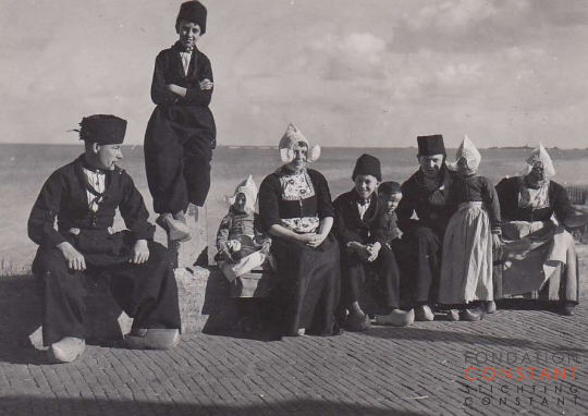 Constant, Jan and seven others in traditional Dutch costumes