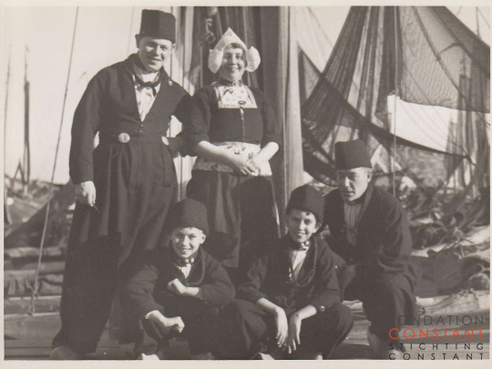 Constant, Jan and three others in traditional Dutch costumes